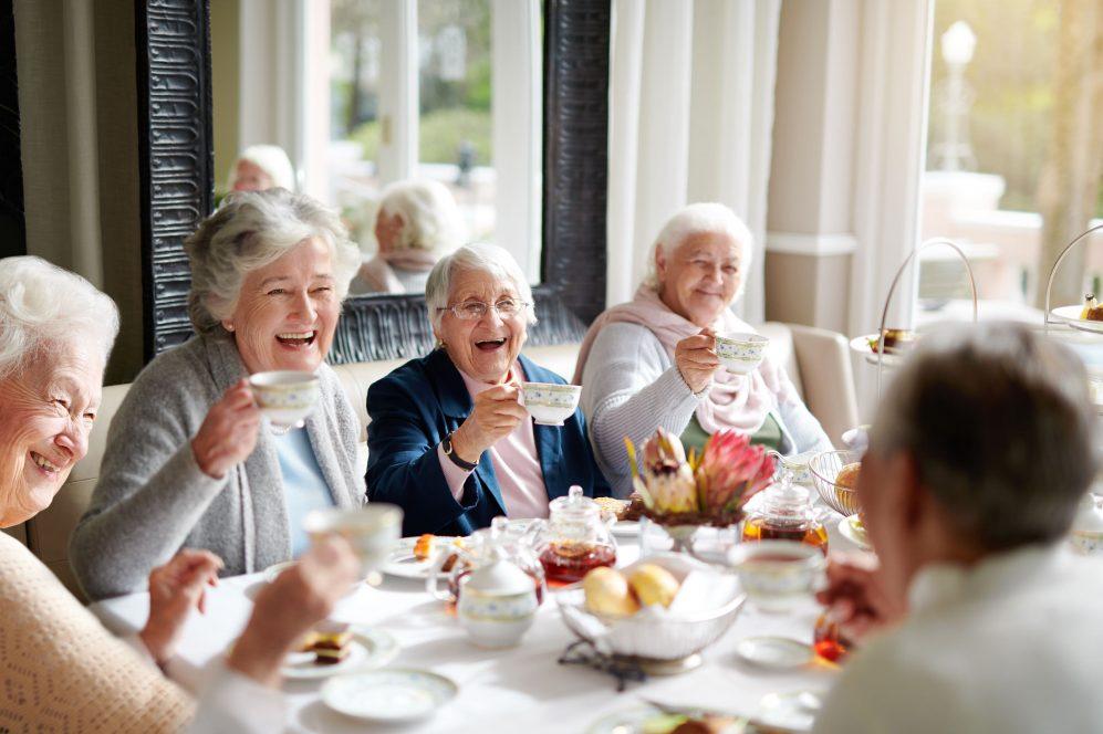 group of senior women having tea