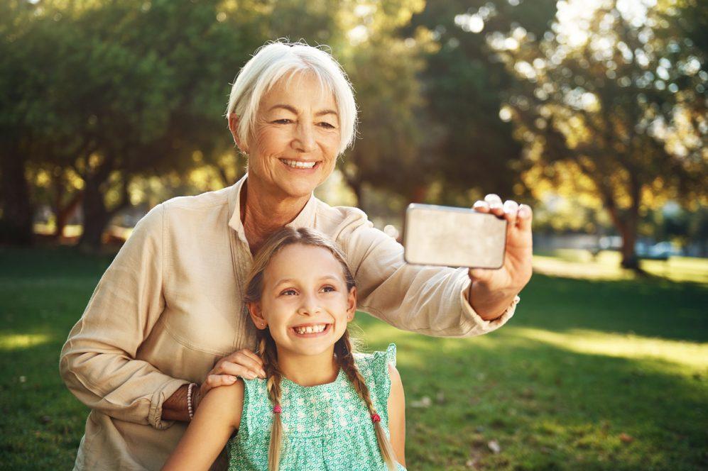 senior woman and grandchild taking selfie