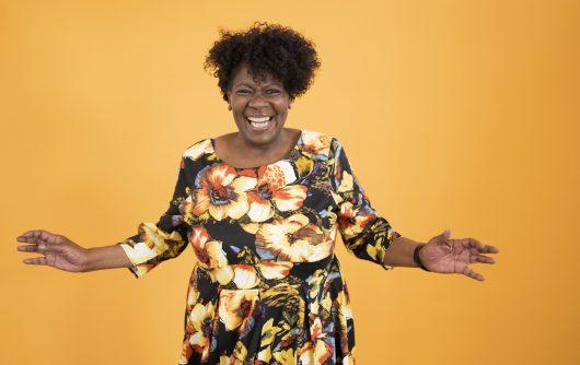 Informal portrait of early 60s black woman full of vitality