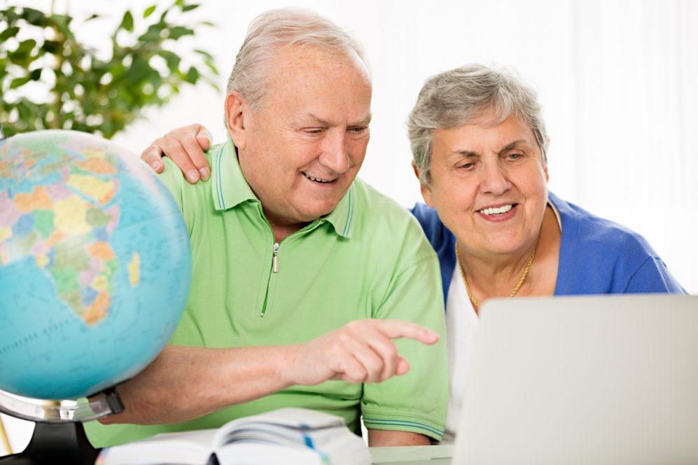Senior couple planning travel destination
