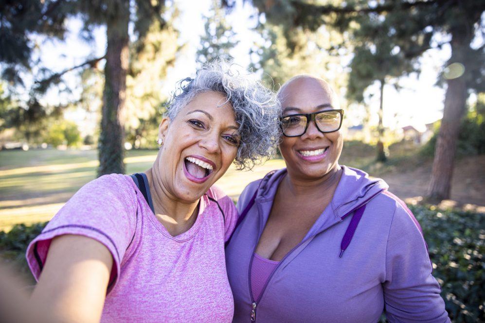 Two black lady friends taking selfies